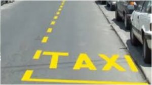 zuta taxi oznaka na kolovozu